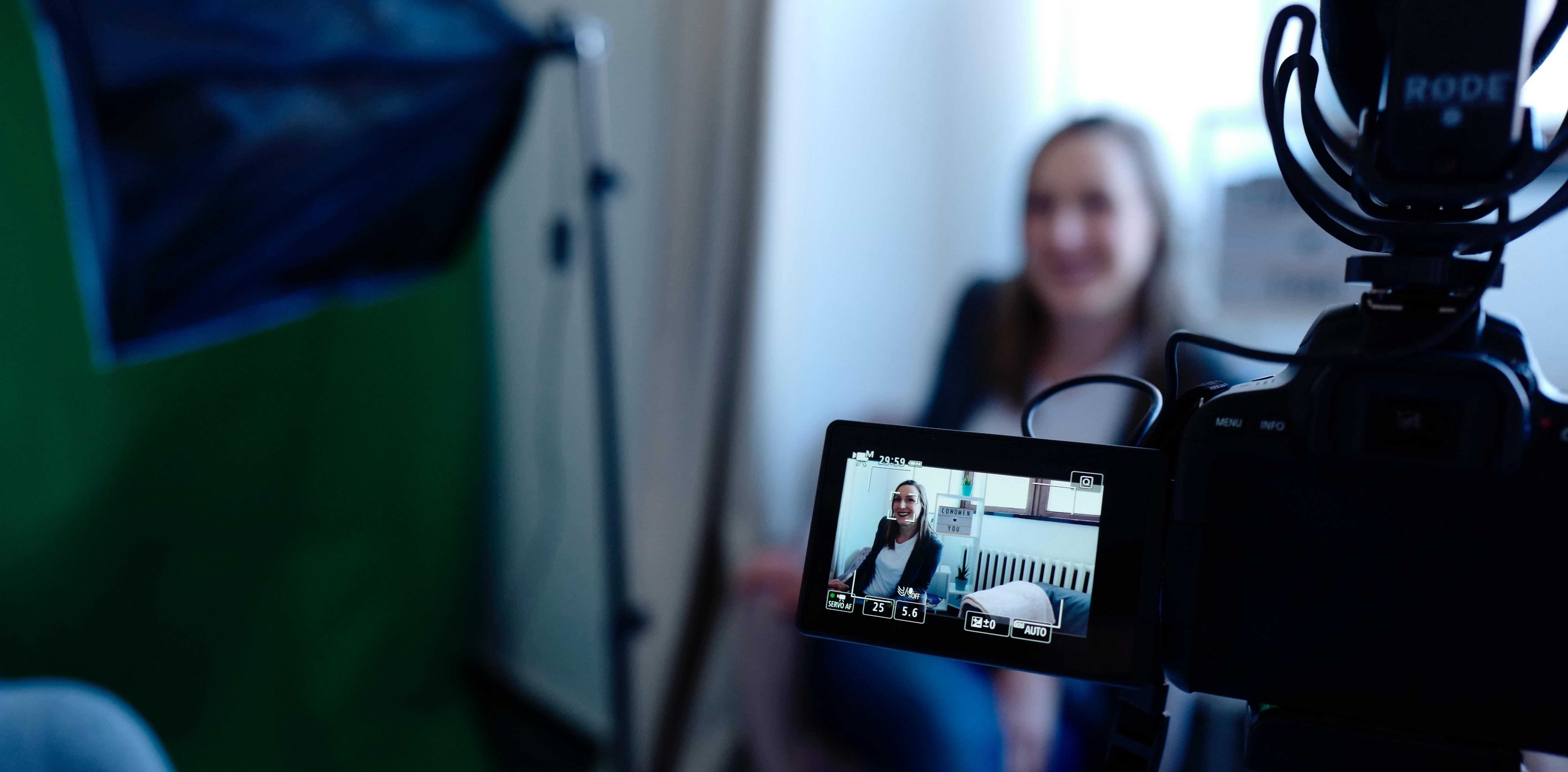 Video camera focusing on woman